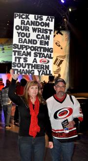 A couple of fans hoping for the magical wrist band that got select few in to see the NHL Fantasy Draft.