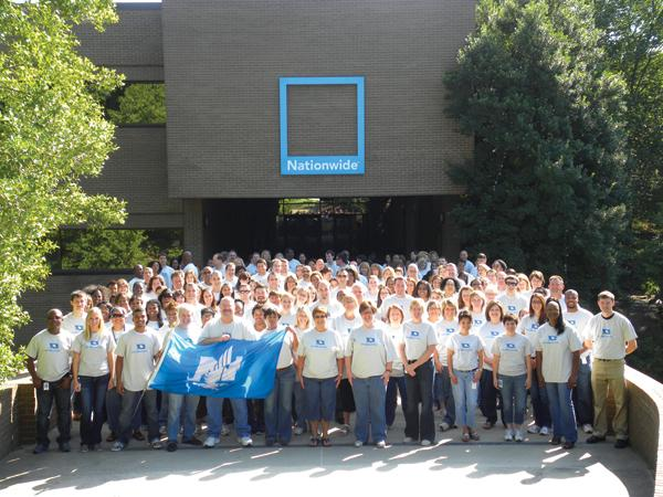 Some of Nationwide's local employees gather to show the company's colors.