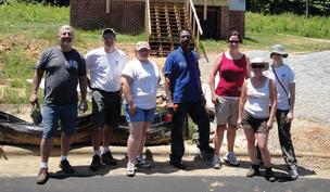 NetApp employees take a break from working on a Habitat for Humanity build.