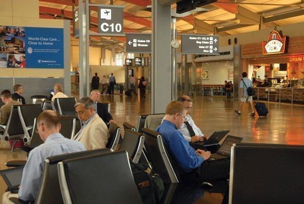 Passengers play the waiting game at Raleigh-Durham International Airport.