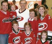 Rob and other family members at a Hurricanes game.