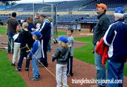 Kids wait in line for a chance to take batting practice.