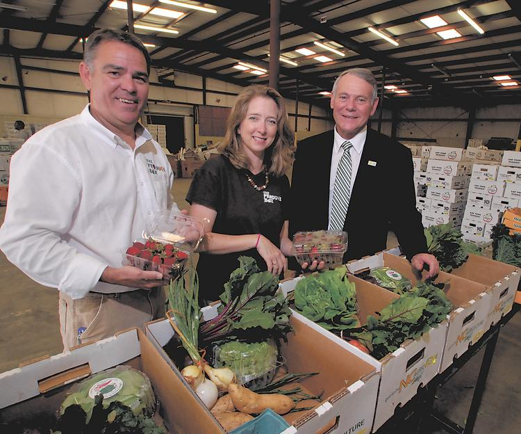 The Produce Box's Kevin O'Connell, left, Courtney Tellefsen, center, and Deputy Agriculture Commissioner Richard Reich check out the bounty.