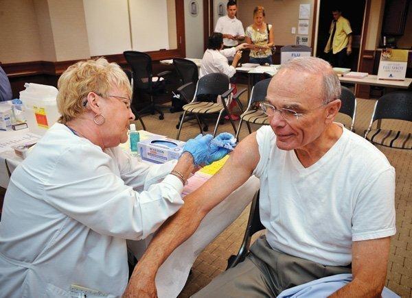 UNC's Vice Chancellor Richard Mann gets a flu shot from nurse Fran Whitfield at UNC Hospitals.
