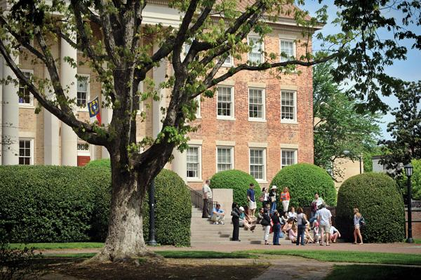 Students gather outside South Building on the UNC-CH campus.