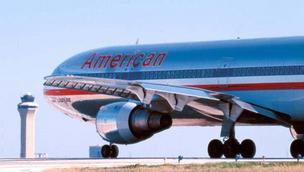 AMR Corp., the parent of American Airlines, reported a first quarter loss of $1.7 billion.