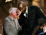 Dean Smith congratulates former player James Worthy after he was inducted into the Basketball Hall of Fame in 2003.