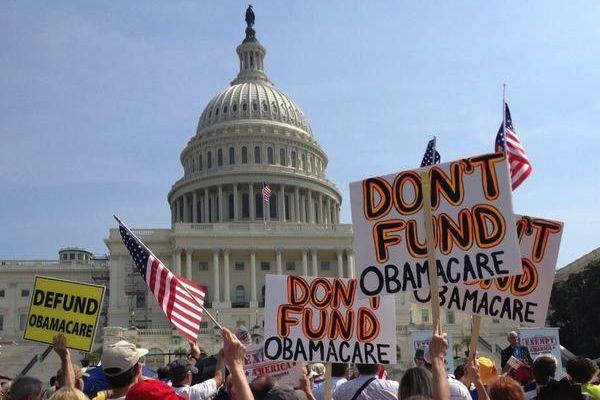 Obamacare is politically divisive, but it's not the end of the world that Republicans are painting it to be, a political science professor tells the DBJ.
