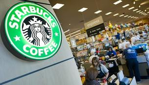 Starting in May, customers purchasing Starbucks packaged coffee in grocery stores will be able to earn rewards to use in Starbucks shops, the company announced at its annual shareholders meeting in Seattle.