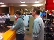 Two young men making a purchase at Macy's at Southdale Center in Edina around 1:30 a.m. on Black Friday.