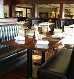 Axel's owner settles suit with Woodbury restaurant