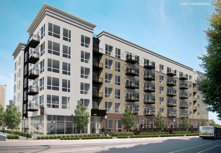The Star Tribune is selling a portion of a parking lot in the North Loop district to apartment developers Curt Gunsburry and Rob Miller who are planning a six-story project.