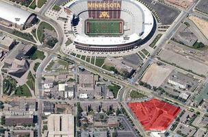 The redevelopment site is shaded in red.