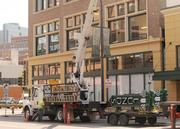Workers were installing exterior signage on the new downtown Minneapolis Lunds grocery store on Wednesday.