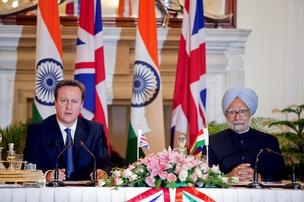 David Cameron, U.K. prime minister, left, speaks while Manmohan Singh, India's prime minister, listens during a news conference at Hyderabad House in New Delhi, India, on Tuesday. Cameron said he wants to see rapid progress on a European Union-India free trade agreement as a way of boosting economic growth.