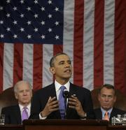 U.S. President Barack Obama delivers the State of the Union address to a joint session of Congress with Vice President Joe Biden, back left, and House Speaker John Boehner, back right, at the Capitol in Washington, D.C., on Tuesday. Obama called for raising the federal minimum wage to $9 an hour.