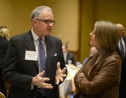 Michael Langley fo Greater MSP and Judy Poferl of Xcel Energy.