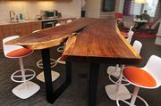 """Accenture's kitchen table is made from a felled Walnut tree procured by F2 Manufacturing in Hudson, Wis. """"Usually we see wood that's so highly processed and removed from what it was,"""" says HGA Architects and Engineers Vice President Rich Bonnin. """"This looks like it was just cut out of the log and finished."""""""