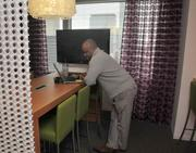 Accenture's workers can plug in at about 90 workstations in the office.