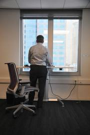 Standing desks offer workers high-rise views of downtown Minneapolis.