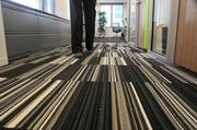 The carpeting in Accenture's office is 68 percent recycled and 100 percent recyclable. The office used an alternative adhesive instead of noxious chemical-emitting carpet glues.