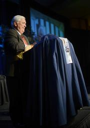 Randy Hogan,CEO of Pentair and theMinneapolis/St. Paul Business Journal 2012 Executive of the Year, brought a cape and a crown for Baker.