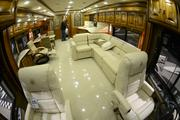 The front seats, followed by a seating area, and then the kitchen. This Tiffin Allegro is 43.5 feet long and almost 13 feet tall.