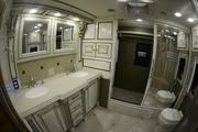 Bathroom and shower on the Tiffin Phaeton. This RV can hold 90 gallons of fresh water, 50 gallons of waste water, and 66 gallons of grey water, which is created by doing laundry and washing dishes.