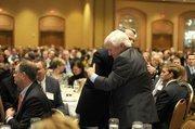 Hogan getting a hug from U.S. Bancorp Richard Davis