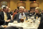U.S. Bancorp CEO Richard Davis, Randy Hogan, and Hogan's wife, Sara.