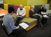 Olson has lots of places for a meeting in an open space. From left to right: Dan Shanghnessy, Jake Coldren, Katie Meehan, and Jen Adams.