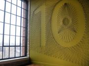 Local artist Danica Adler was hired to create string designs that are installed on walls outside of each elevator door.