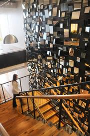 A mirrored wall alongside a staircase that adjoins Olson's four floors.
