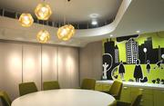 "Small conference rooms like this are on each floor, and each has different ""city-themed"" designs on its walls."