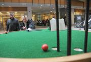 """Brian Turnquist, playing the 1st hole with a """"cue stick."""""""