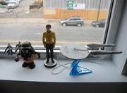 Star Trek action figures rest on the window cell of the tidy office. Growing up in a small town by Albert Lea, Schermer's family only got three TV channels. He was never able to watch Star Trek unless they visited his cousins, who lived in the Twin Cities.