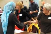 Suzanne Gaines of Hennepin County greets the student she is to interview.