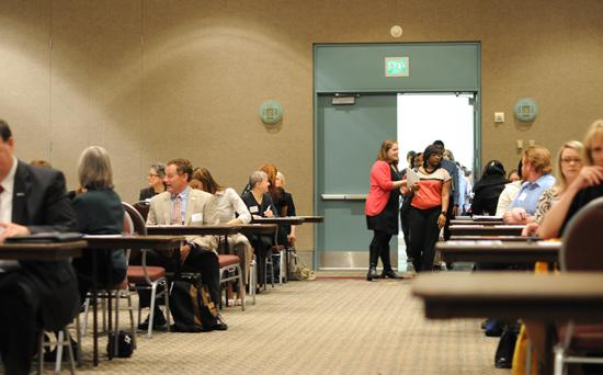About 100 students were let into a ballroom at the Minneapolis Convention Center and randomly chose a business person to sit with. About 400 students met with business people Monday, and 1,600 will meet with them over a four-day period.