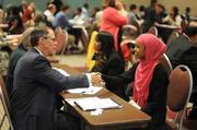 Hibaq, a sophomore from Columbia Heights, shakes hands with U.S. Bancorp CEO Richard Davis after interviewing with him.