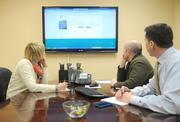 Kueppers and other staff members have a conference call with a client.