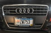 Kueppers jumps in his black Audi with Woodward and heads back to the office. His license plate advertises his alma mater, St. John's University.