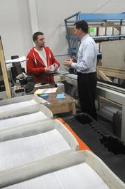 Before leaving the office, Kueppers checks up on his employees in the warehouse.