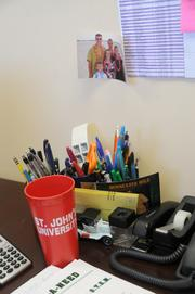 With red and white college memorabilia, Kueppers' office is a shrine to his alma matter, St. John's University.