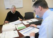 In his last meeting of the day, Kueppers discusses sales with Greg Barmore, the vice president of sales and marketing.