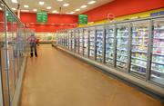 Target is adding another row of enclosed shelving for dairy products.