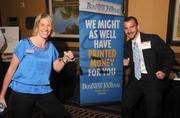 Mandee Kastelic of St. Paul Area Chamber of Commerce pulls an exercise band with Jonathon Weinhagen. Blue Cross and Blue Shield of Minnesota gave out the bands at the event.
