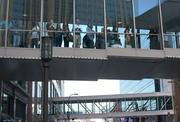 Onlookers in the Nicollet Mall Skyway watch the scene.