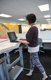 Amanda Meuwissen works while walking on a treadmill.