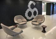 A wall of removable blocks in the main lobby allows employees to create their own designs.