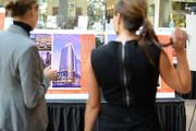 Two women looking at renderings of the Nicollet Residences, a$100 million, 33-story luxury-apartment tower for an area known as the Powers site in downtown Minneapolis.>Click here to see the renderings.